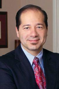 Dr. Gus Alva